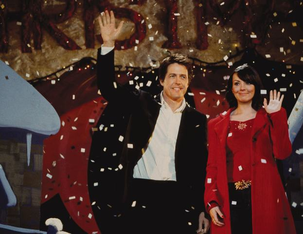 Quality: Original.  Film Title: Love Actually.  Pictured: THE PRIME MINISTER (HUGH GRANT), NATALIE (MARTINE McCUTCHEON).      Photo Credit: © Peter Mountain.  Copyright:  © 2003 Universal Studios. ALL RIGHTS RESERVED.