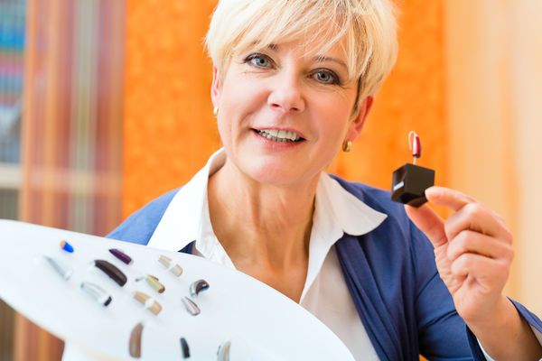Deaf woman with hearing aid