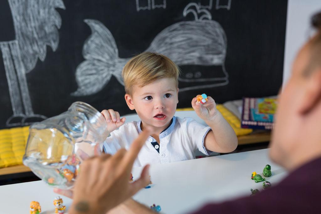 Cute little toddler boy at speechtherapist session.