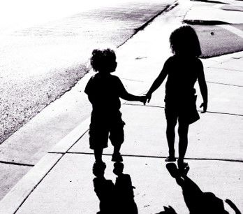adorable-children-silhouettes-boy-and-girl-holding-hands-picture-id121351839-f